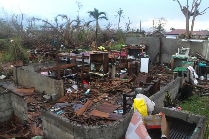 pieces of a home scattered by a hurricane