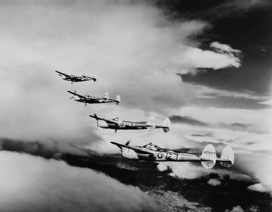 An archival photo shows U.S. Air Force bombers flying in formation during World War II.